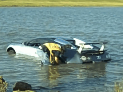 There Is Bugatti Veyron In The Lake Completely. Salt Lake Is Also A Place  To Worry About Car Damage.