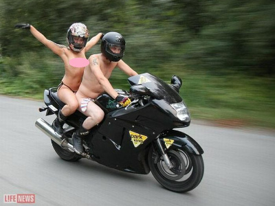Nude girl riding motorcycle