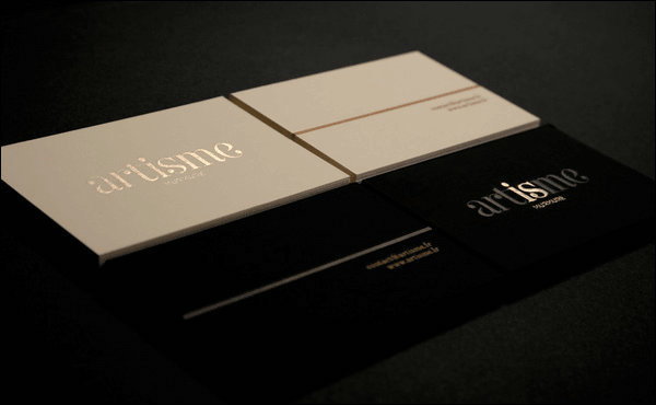 Business card design that gives impact to opponent in color and on one side is a black character on a white background and on the other side a business card written with a character by embossing on a white colourmoves