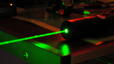 Succeeded in developing a portable laser gun capable of
